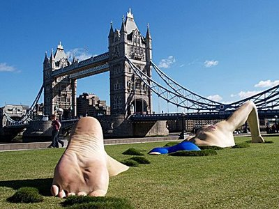 Tatto-ed giant swims beside theThames